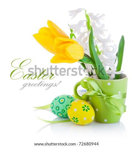 spring flowers with easter eggs isolated on white background - stock photo