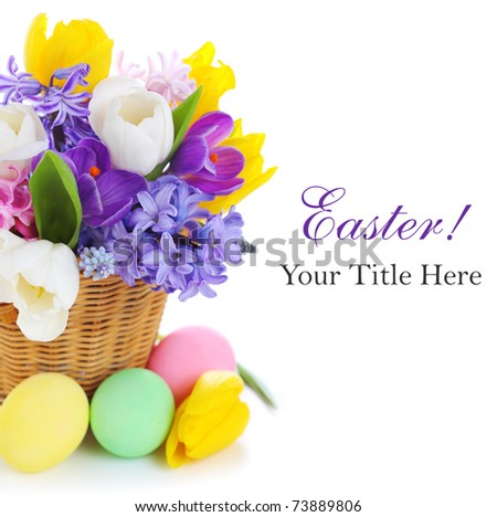 spring flowers with easter eggs on white isolated background - stock photo