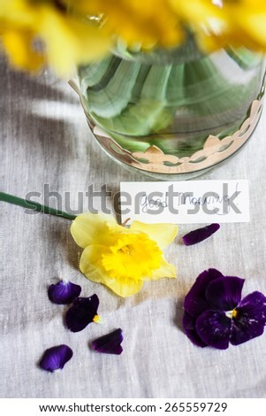 Spring flowers with good morning note - stock photo