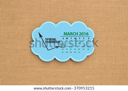 Spring Forward (Daylight Savings Time Begins) March 13, 2016 Calendar Cloud hanging on Canvas Board Background