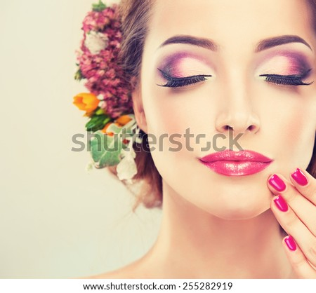 Spring freshness. Girl with delicate pastel flowers in hair - stock photo
