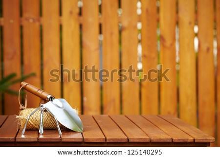 Spring garden tools background - stock photo