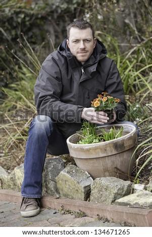 spring garden work.    young man doing garden work. - stock photo
