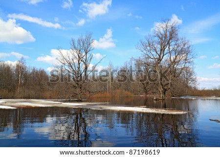 spring ice on small river - stock photo
