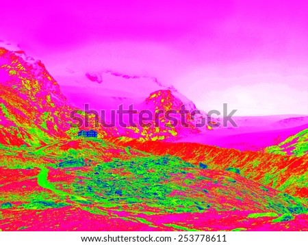 Spring in Alpine mountains in infrared photo. Mountain hotel in hilly landscape. Sunny weather with clear sky above. Amazing thermography colors. - stock photo