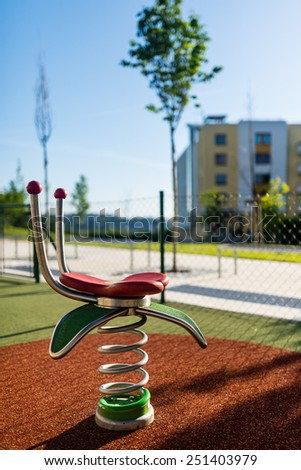 Spring in the empty children playground in the city  - stock photo