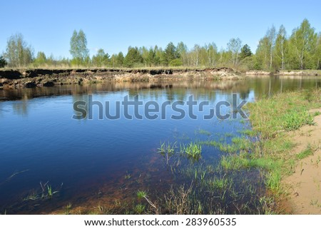 Spring in the national Park. Spring landscape, the river and the first greens in the trees. - stock photo