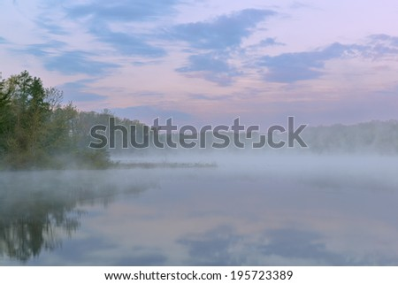 Spring landscape at dawn of Deep Lake in fog, Yankee Springs State Park, Michigan, USA - stock photo