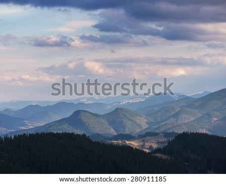 Spring landscape. Beautiful clouds over the mountains - stock photo