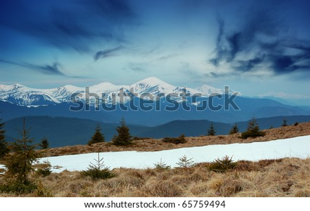 Spring landscape in mountains with snow tops. Ukraine, mountains Carpathians.