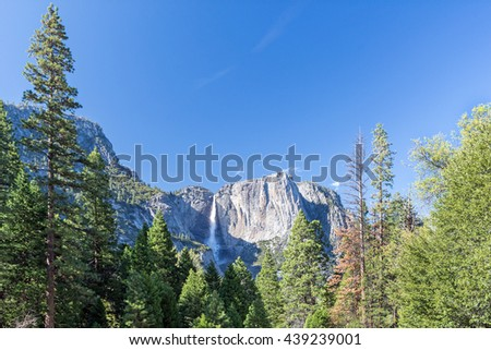 spring landscape of Yosemite valley with waterfall  - stock photo