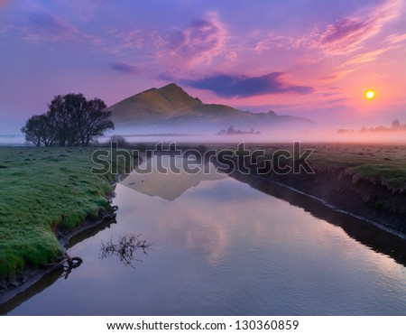 Spring landscape on the river near the mountains. Sunrise - stock photo