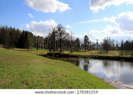 spring landscape with blue sky, river, forest - stock photo