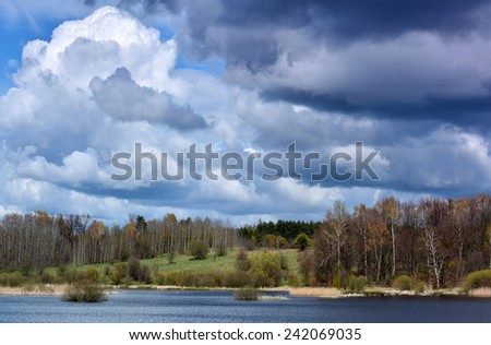 Spring landscape with lake and forest - stock photo