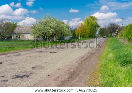 Spring landscape with old road through Dmukhailivka village, Dnepropetrovskaya oblast, Ukraine - stock photo