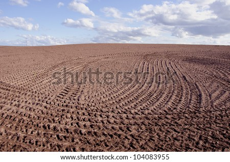 spring landscape with tillage and sky clouds - stock photo