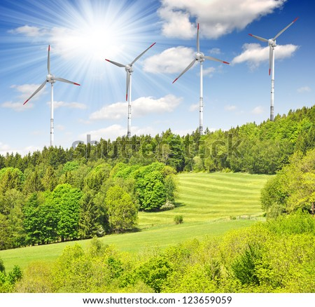 spring landscape with wind turbine - stock photo
