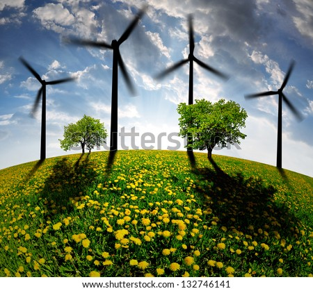 spring landscape with wind turbine in the sunset - stock photo