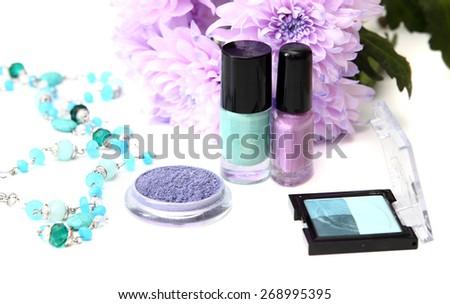 spring make-up and cosmetics - nail polishes, shadow - stock photo