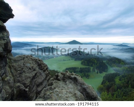 Spring misty landscape. Early morning in a beautiful mountain of Bohemian-Saxony Switzerland. Peaks of hills increased from fog.  - stock photo