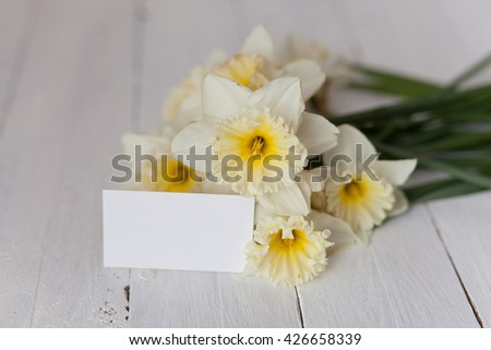 Spring narcissus with blank card