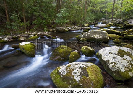Spring on Sam's Creek Huge boulders litter the streambed of Sam's Creek, Great Smoky Mountains National Park, Tennessee. - stock photo