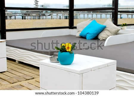 Spring on the coast. Flowers on the table in the beach club in The Hague. Netherlands. den Haag - stock photo