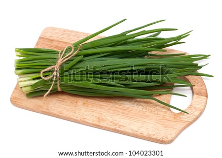 spring onion on cutting board isolated on white - stock photo
