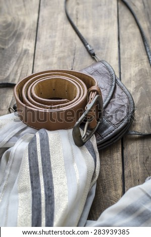 Spring or summer women's fashion accessories lying on table - stock photo
