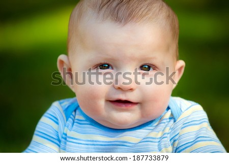 Spring outdoor portrait of infant baby boy - stock photo