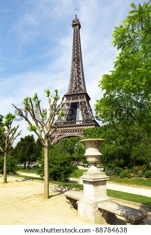 Spring park with Eiffel tower - stock photo