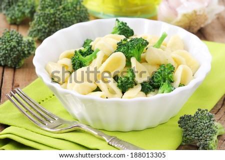 Spring pasta - Orecchiette with broccoli in a white plate - stock photo
