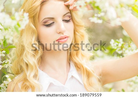 Spring portrait of a beautiful young blonde woman.