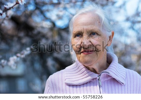 Spring portrait of elderly woman - stock photo