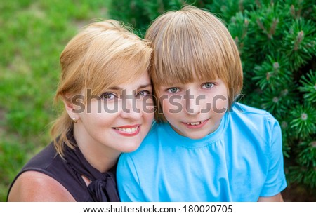 Spring portrait of mother and son - stock photo