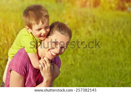 Spring portrait of mother and son on Mother's Day. Family walk in the park - stock photo