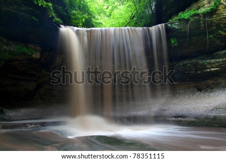 Spring rains create a beautiful scene at Lasalle Falls of Starved Rock State Park in central Illinois - stock photo
