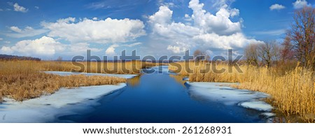 Spring river landscape. Ice melts. River Mzha, Kharkiv region, Ukraine. - stock photo
