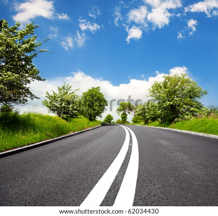 Spring road - stock photo