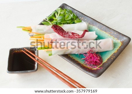 Spring roll of carrot and cucumber with soy sauce