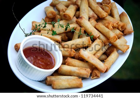 Spring rolls and chilli sauce at wedding reception - stock photo
