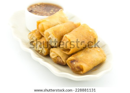 Spring rolls, Homemade egg rolls or Fried Chinese Traditional Spring rolls food with chili dipping sauce In Thai Restaurant. - stock photo