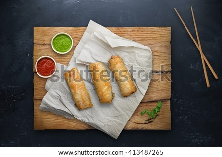 Spring rolls with rice on black background