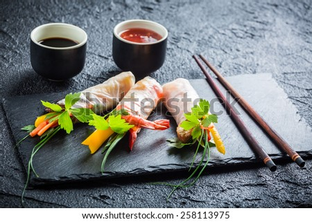 Spring rolls with vegetables served with soy sauce - stock photo