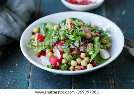 spring salad with chickpea in white bowl - stock photo