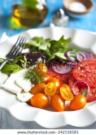 Spring salad with feta - stock photo