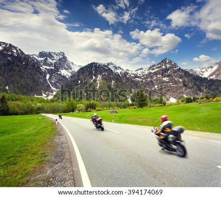 Spring scene in the Swiss Alps. Riding on motorcycles in the mountain pass. Switzerland, Europe. - stock photo