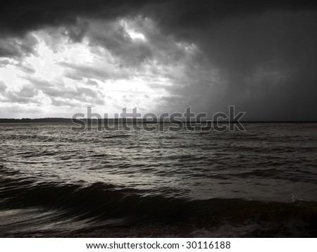 Spring storm brewing along the edge of the Potomac River near Nanjemoy, MD. - stock photo