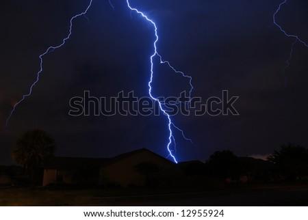 Spring storm lightning strike in a local neighborhood - stock photo