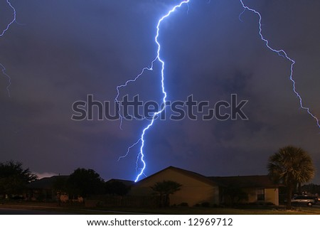 Spring storm lightning strike in a local neighborhood - stock photo